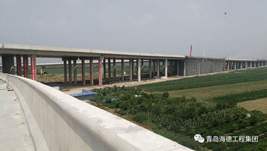 青岛海德工程集团:新机场高速项目最后一联现浇箱梁金洋2牌混凝土浇筑完成